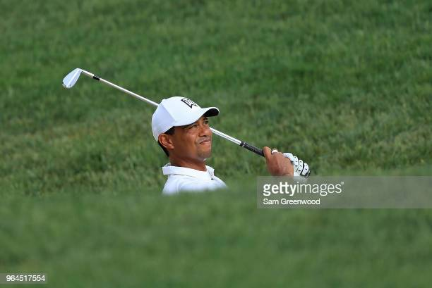 Tiger Woods of the United States hits his third shot on the 13th hole during the first round of The Memorial Tournament Presented by Nationwide at...
