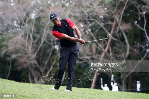 Tiger Woods of the United States hits his third shot on the 14th hole during the final round of the Zozo Championship at Accordia Golf Narashino...