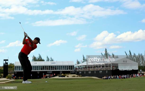 Tiger Woods of the United States hits is approach shot on the 18th hole during the final round of the Hero World Challenge at Albany on December 07,...