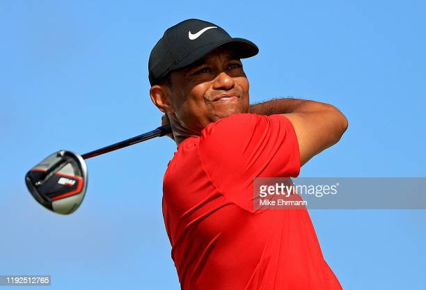 Tiger Woods of the United States hits is tee shot on the fourth hole during the final round of the Hero World Challenge at Albany on December 07,...