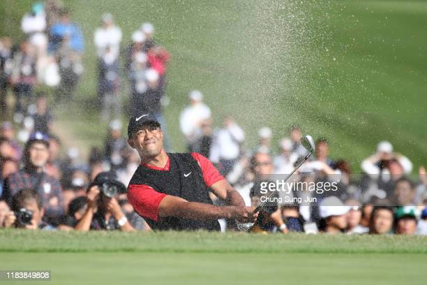 Tiger Woods of the United States hits out from a bunker on the 18th hole during the final round of the Zozo Championship at Accordia Golf Narashino...