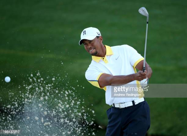 Tiger Woods of the United States hits out of the bunker on the 16th hole during the second round of the 2013 Masters Tournament at Augusta National...