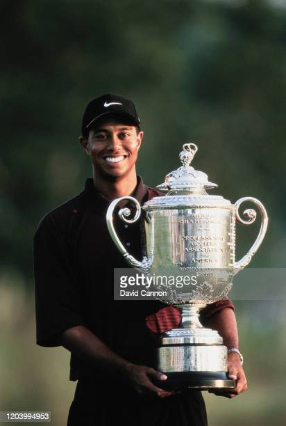 Tiger Woods of the United States holds the Wanamaker Trophy after winning the Professional Golfers' Association of America 82nd PGA Championship golf...