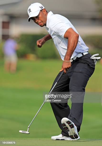 Tiger Woods of the United States holes a putt for eagle at the par 5, 16th hole during the third round of the 2013 Arnold Palmer Invitational...