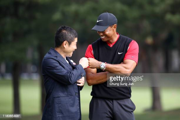 Tiger Woods of the United States is congratulated by the Zozo founder Yusaku Maezawa at the award ceremony following the final round of the Zozo...