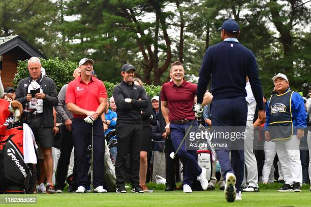 Tiger Woods of the United States is welcomed by former rugby players Mike Tindall of England, Brian O'Driscoll of Ireland and Rory McIlroy of...