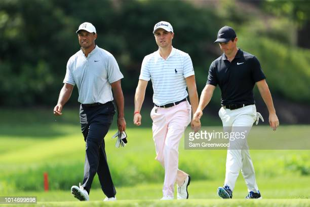 Tiger Woods of the United States Justin Thomas of the United States and Rory McIlroy of Northern Ireland walk on the eighth hole during the second...