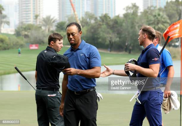Tiger Woods of the United States leaves the ninth green at the end of his five over par first round as his playing partners Matthew Fitzpatrick and...