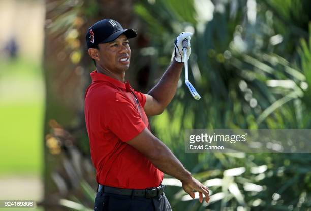 Tiger Woods of the United States lets go of his two iron as he plays his tee shot on the par 4, second hole during the final round of the 2018 Honda...