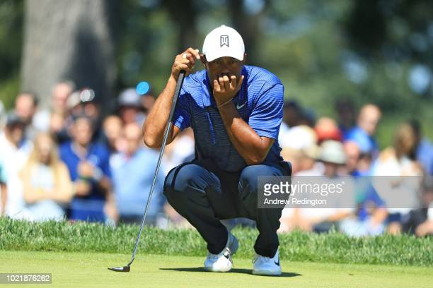 Tiger Woods of the United States lines up a putt during the first round of The Northern Trust on August 23 2018 at the Ridgewood Championship Course...
