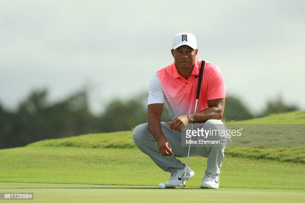Tiger Woods of the United States lines up a putt during the proam prior to the Hero World Challenge at Albany Bahamas on November 29 2017 in Nassau...