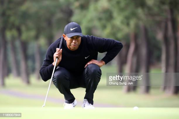 Tiger Woods of the United States lines up a putt on the 11th green during the first round of the ZOZO Championship at Accordia Golf Narashino Country...