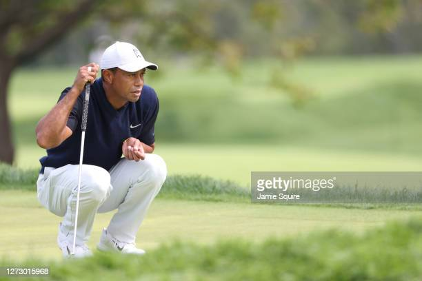 Tiger Woods of the United States lines up a putt on the 11th green during the first round of the 120th U.S. Open Championship on September 17, 2020...