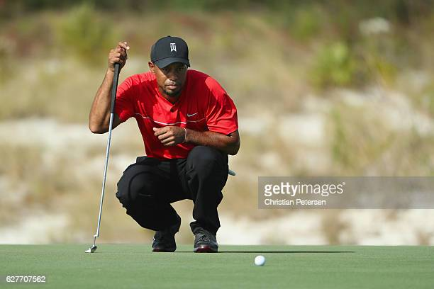 Tiger Woods of the United States lines up a putt on the 11th hole during the final round of the Hero World Challenge at Albany The Bahamas on...