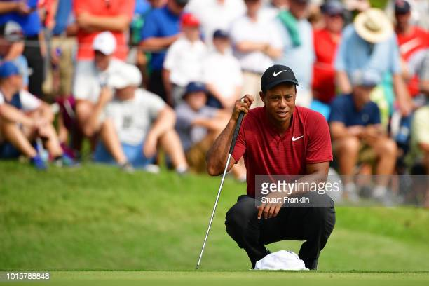 Tiger Woods of the United States lines up a putt on the 12th green during the final round of the 2018 PGA Championship at Bellerive Country Club on...