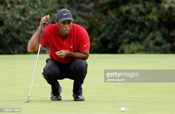Tiger Woods of the United States lines up a putt on the 14th green during the final round of the Masters at Augusta National Golf Club on November...
