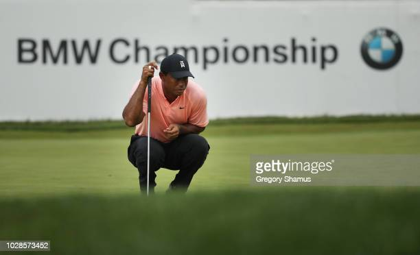 Tiger Woods of the United States lines up a putt on the 18th green during the second round of the BMW Championship at Aronimink Golf Club on...