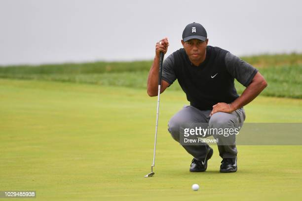 Tiger Woods of the United States lines up a putt on the 18th green during the third round of the BMW Championship at Aronimink Golf Club on September...