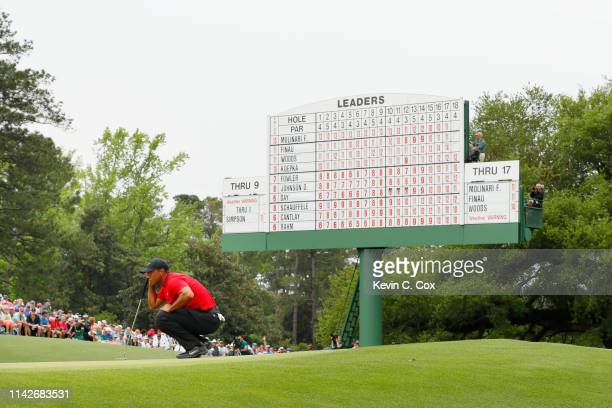 Tiger Woods of the United States lines up a putt on the 18th green during the final round of the Masters at Augusta National Golf Club on April 14...