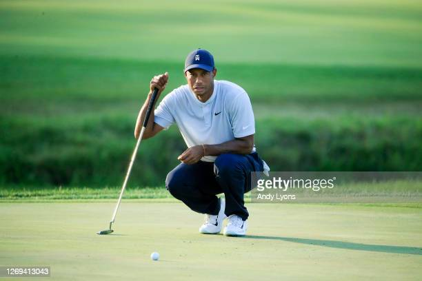 Tiger Woods of the United States lines up a putt on the 18th green during the second round of the BMW Championship on the North Course at Olympia...