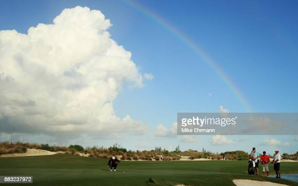 Tiger Woods of the United States lines up a putt on the 18th green during the first round of the Hero World Challenge at Albany Bahamas on November...