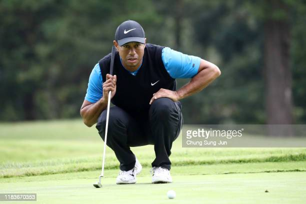 Tiger Woods of the United States lines up a putt on the 2nd green during the third round of the Zozo Championship at Accordia Golf Narashino Country...