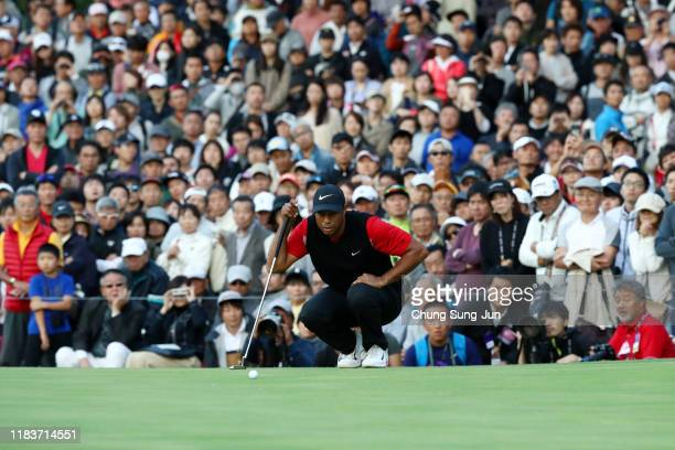 Tiger Woods of the United States lines up a putt on the 9th green during the final round of the Zozo Championship at Accordia Golf Narashino Country...