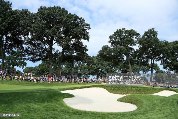 Tiger Woods of the United States lines up a putt on the fifth green during the final round of The Northern Trust on August 26 2018 at the Ridgewood...