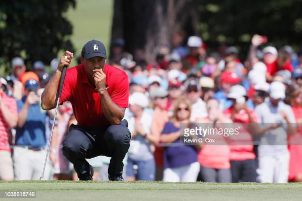 Tiger Woods of the United States lines up a putt on the fifth green during the final round of the TOUR Championship at East Lake Golf Club on...