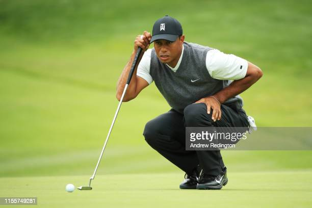 Tiger Woods of the United States lines up a putt on the first green during the first round of the 2019 U.S. Open at Pebble Beach Golf Links on June...