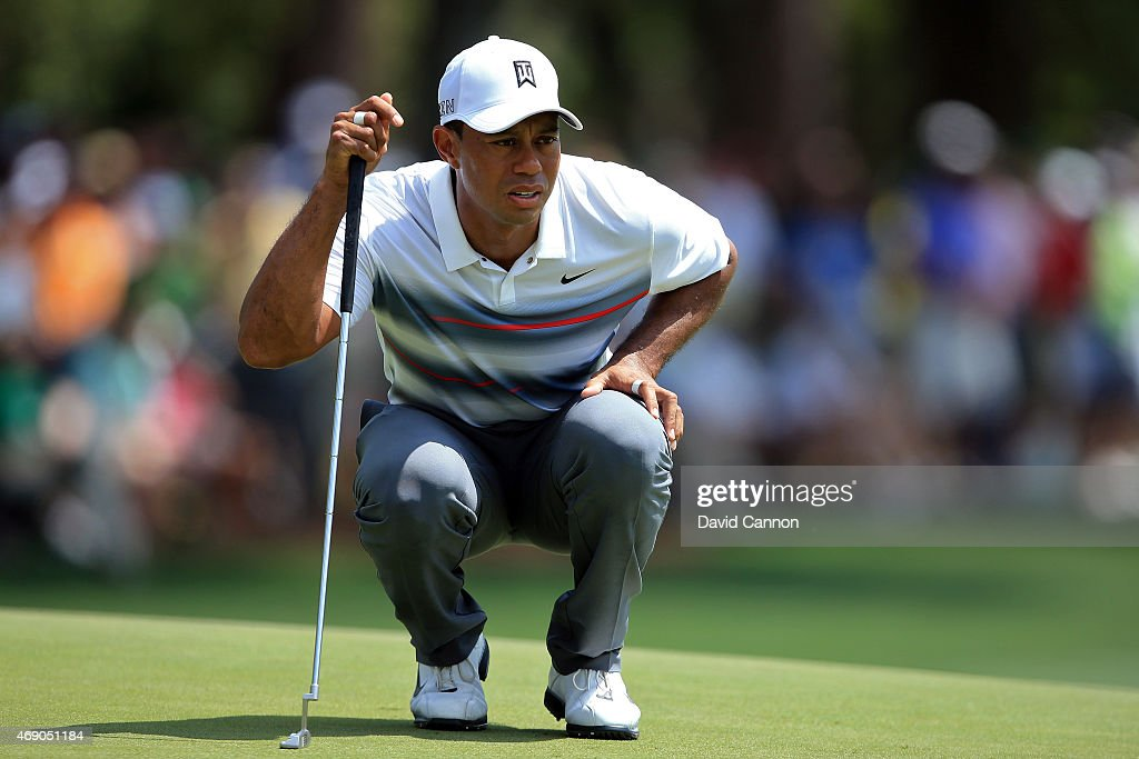 Tiger Woods of the United States lines up a putt on the first green during the first round of the 2015 Masters Tournament at Augusta National Golf Club on April 9, 2015 in Augusta, Georgia.