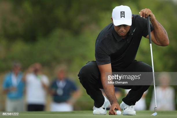 Tiger Woods of the United States lines up a putt on the first green during the first round of the Hero World Challenge at Albany Bahamas on November...