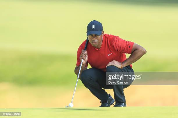 Tiger Woods of the United States lines up a putt on the par 4 12th hole during the final round of the Genesis Invitational at The Riviera Country...