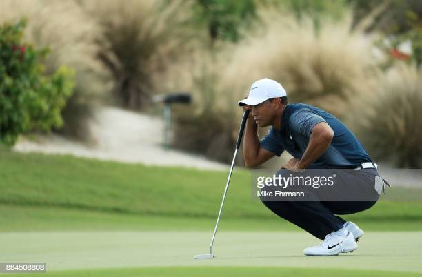 Tiger Woods of the United States lines up a putt on the second green during the third round of the Hero World Challenge at Albany Bahamas on December...