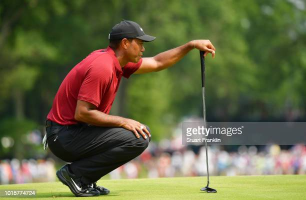 Tiger Woods of the United States lines up a putt on the seventh green during the final round of the 2018 PGA Championship at Bellerive Country Club...