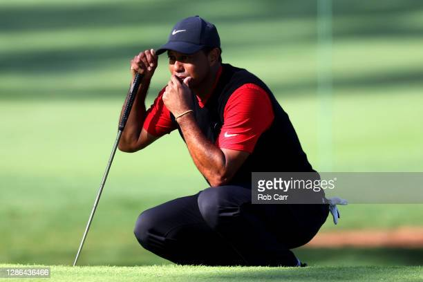 Tiger Woods of the United States lines up a putt on the seventh green during the final round of the Masters at Augusta National Golf Club on November...