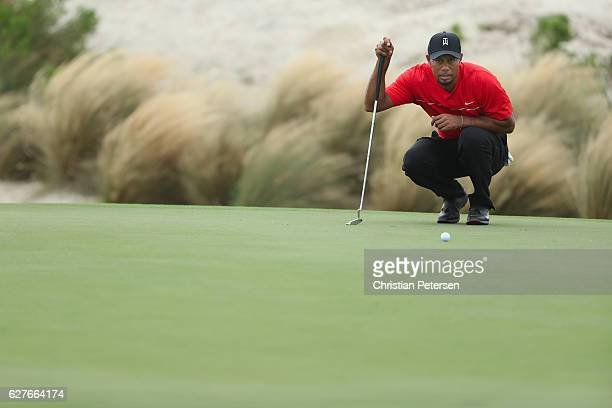 Tiger Woods of the United States lines up his putt on the third hole during the final round of the Hero World Challenge at Albany The Bahamas on...
