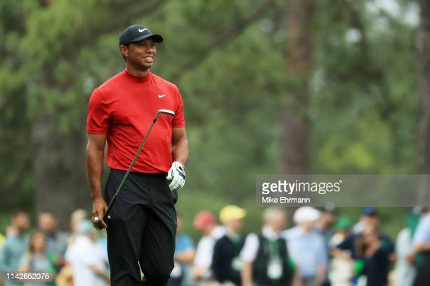 Tiger Woods of the United States looks on after playing an approach on the ninth hole during the final round of the Masters at Augusta National Golf...