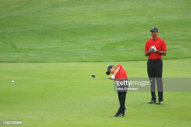 Tiger Woods of the United States looks on as Charlie Woods plays a shot on the third hole during the final round of the PNC Championship at the...