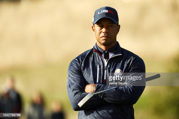 Tiger Woods of the United States looks on during the morning fourball matches of the 2018 Ryder Cup at Le Golf National on September 29 2018 in Paris...