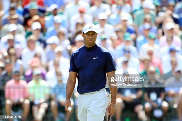 Tiger Woods of the United States looks on from the 15th green during the first round of the Masters at Augusta National Golf Club on April 11 2019 in...