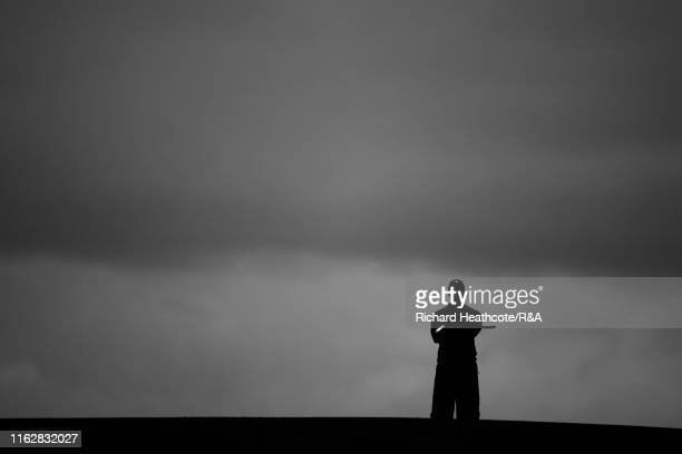 Tiger Woods of the United States looks on from the 17th hole during the first round of the 148th Open Championship held on the Dunluce Links at Royal...