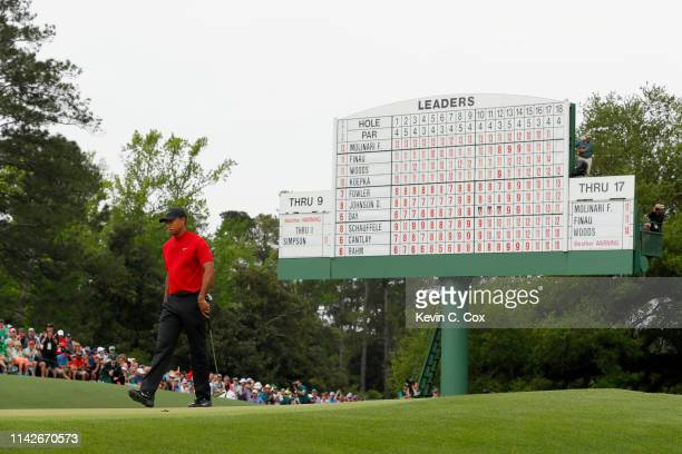 Tiger Woods of the United States looks on from the 18th green during the final round of the Masters at Augusta National Golf Club on April 14, 2019...