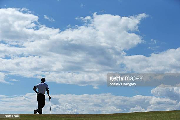 Tiger Woods of the United States looks on from the 4th green during the first round of the 142nd Open Championship at Muirfield on July 18 2013 in...