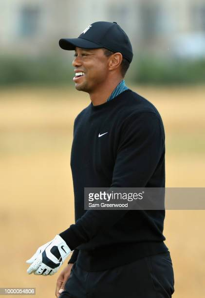 Tiger Woods of the United States looks on on a practice round during previews ahead of the 147th Open Championship at Carnoustie Golf Club on July 16...