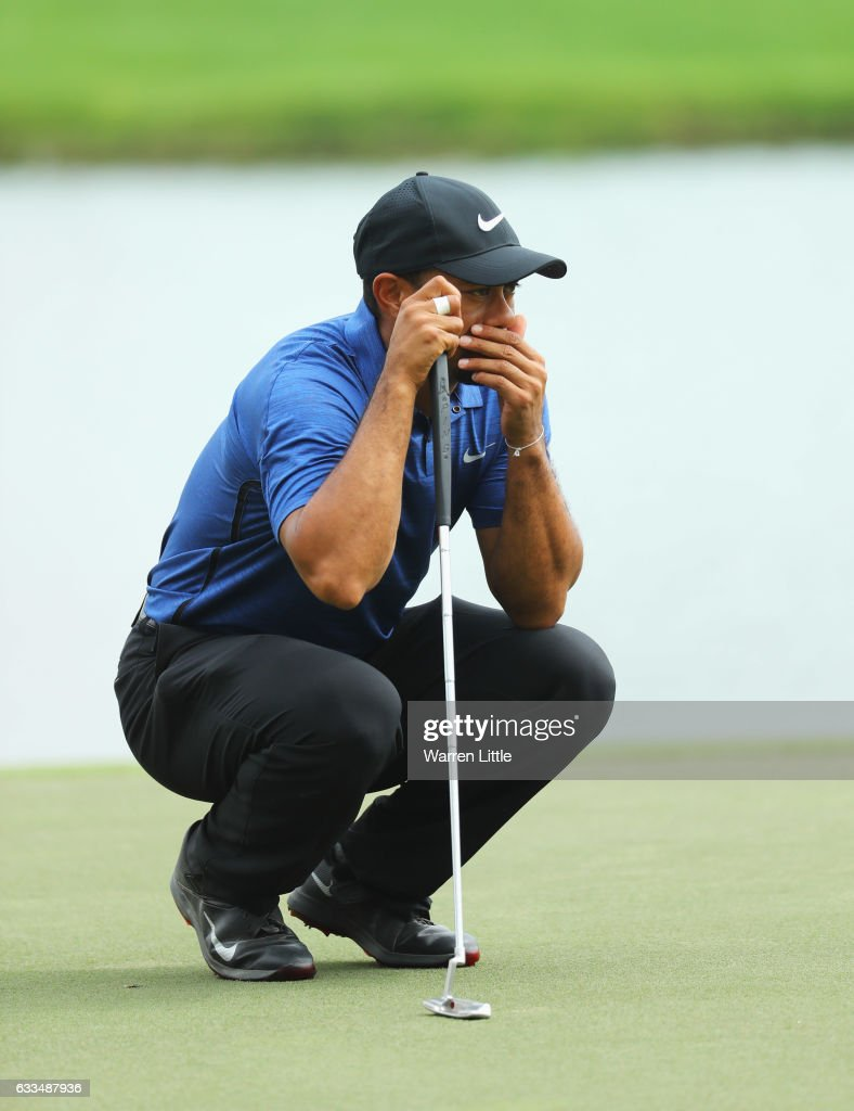Tiger Woods of the United States looks thoughtul as he lines up a putt on the 9th green during the first round of the Omega Dubai Desert Classic at Emirates Golf Club on February 2, 2017 in Dubai, United Arab Emirates.