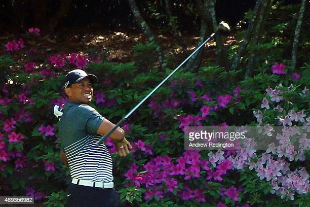 Tiger Woods of the United States loses his driver after a poor tee shot on the 13th hole during the third round of the 2015 Masters Tournament at...