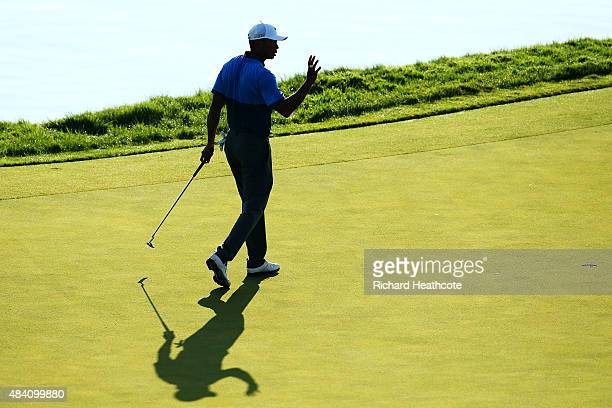 Tiger Woods of the United States makes birdie on the 17th hole during the continuation of the weather-delayed second round of the 2015 PGA...