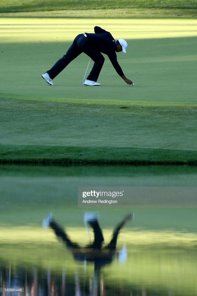 Tiger Woods of the United States marks his ball on the 16th green during the second round of the 2012 Masters Tournament at Augusta National Golf Club on April 6, 2012 in Augusta, Georgia.