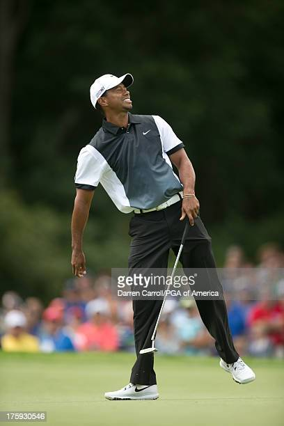 Tiger Woods of the United States misses a birdie putt on 2 during the third round of play at the 95th PGA Championship at Oak Hill Country Club on...